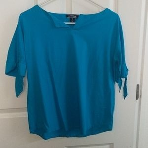 Short, tied sleeve blue blouse